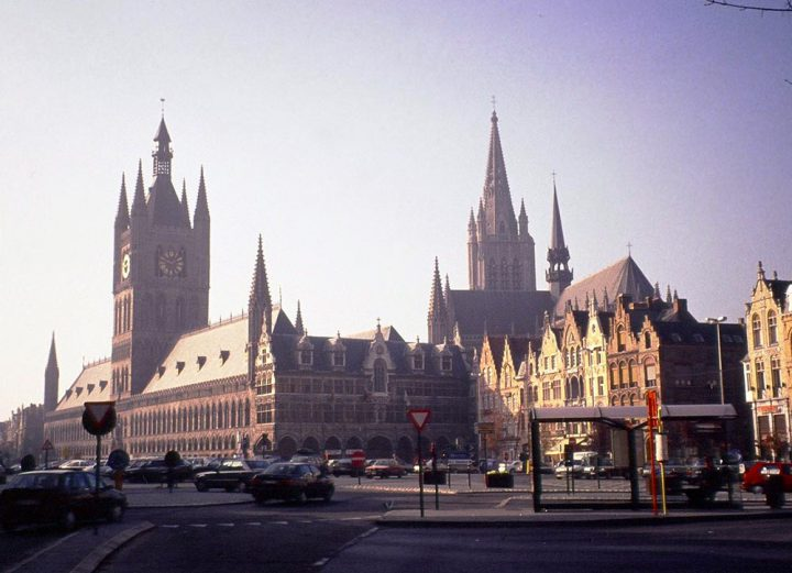 The belfry of the Cloth Hall on the main square of Ieper, Belgium, and the steeple of St Martin's Cathedral.