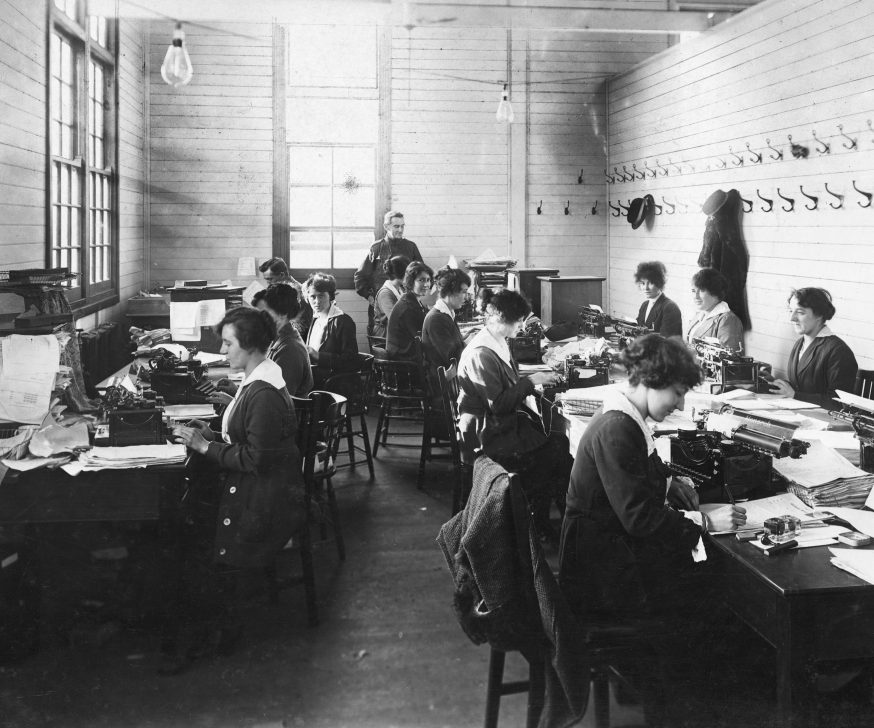 Female clerks seated, working at the Base Records Office in Melbourne